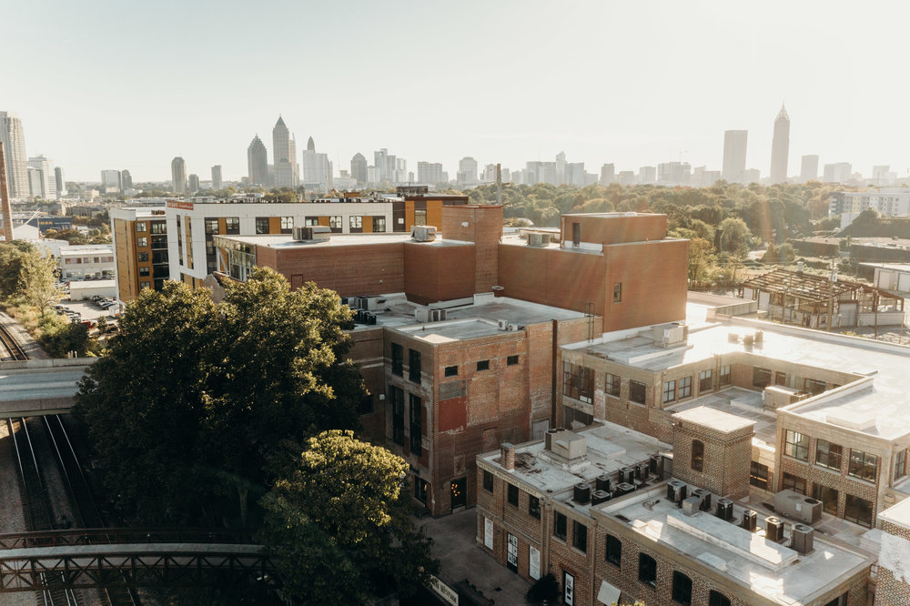 Aerial view of Westside Provisions District with Atlanta skyline in background