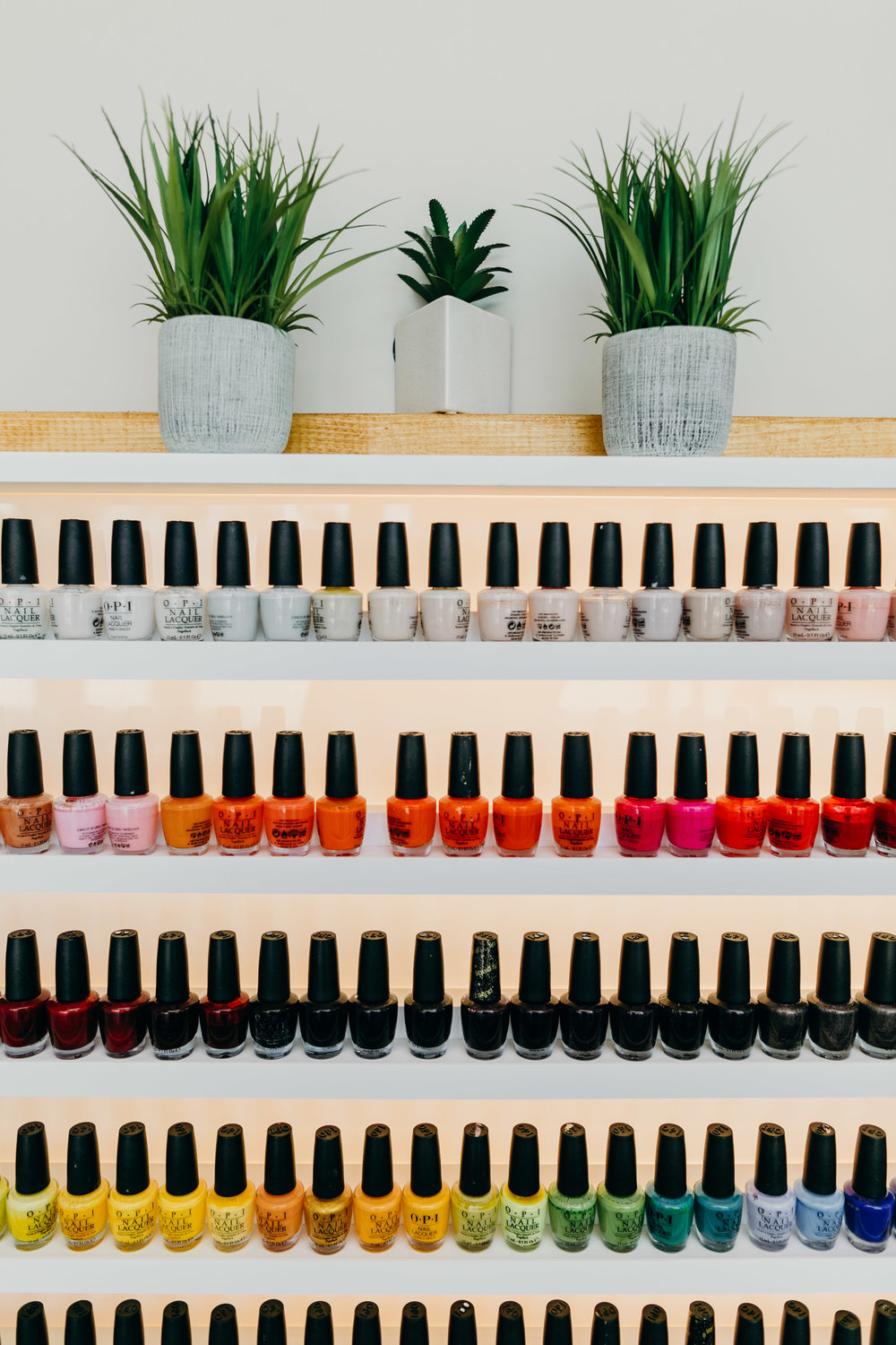 Retail display of multicolored nail polish bottles at Nouvelle Nails