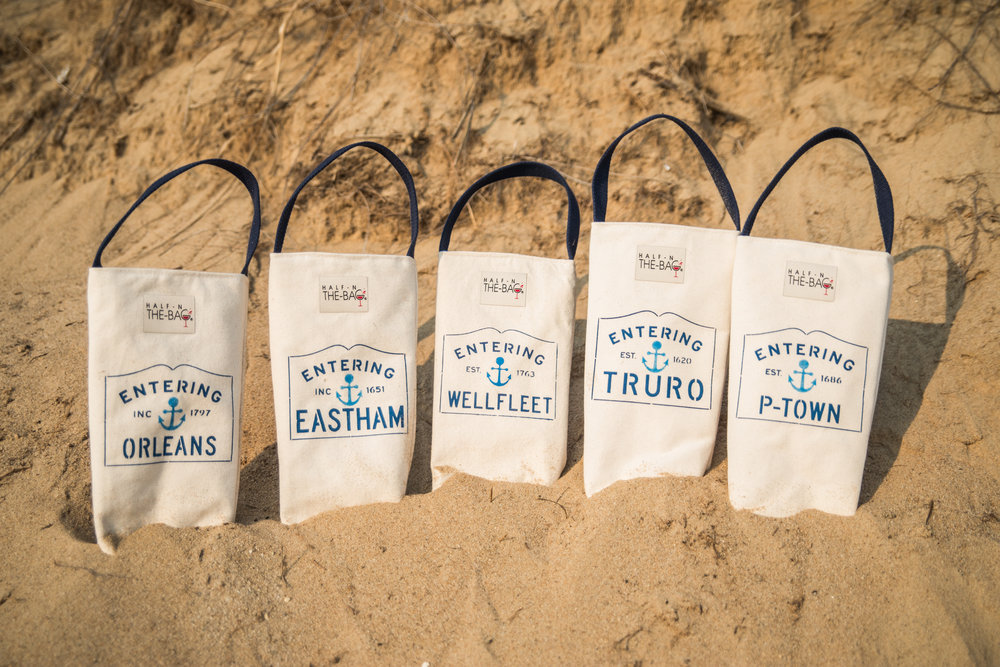 Insulated wine totes made in Massachusetts featuring the five towns that comprise lower Cape Cod.