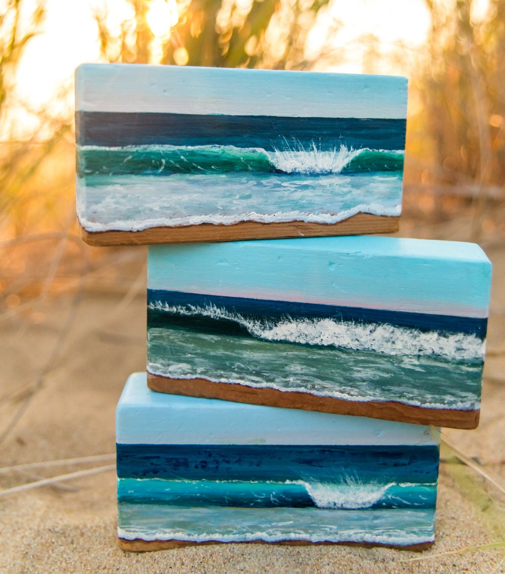 Wave paintings on vintage Playskool blocks by New England artist Carolyn Corrente.