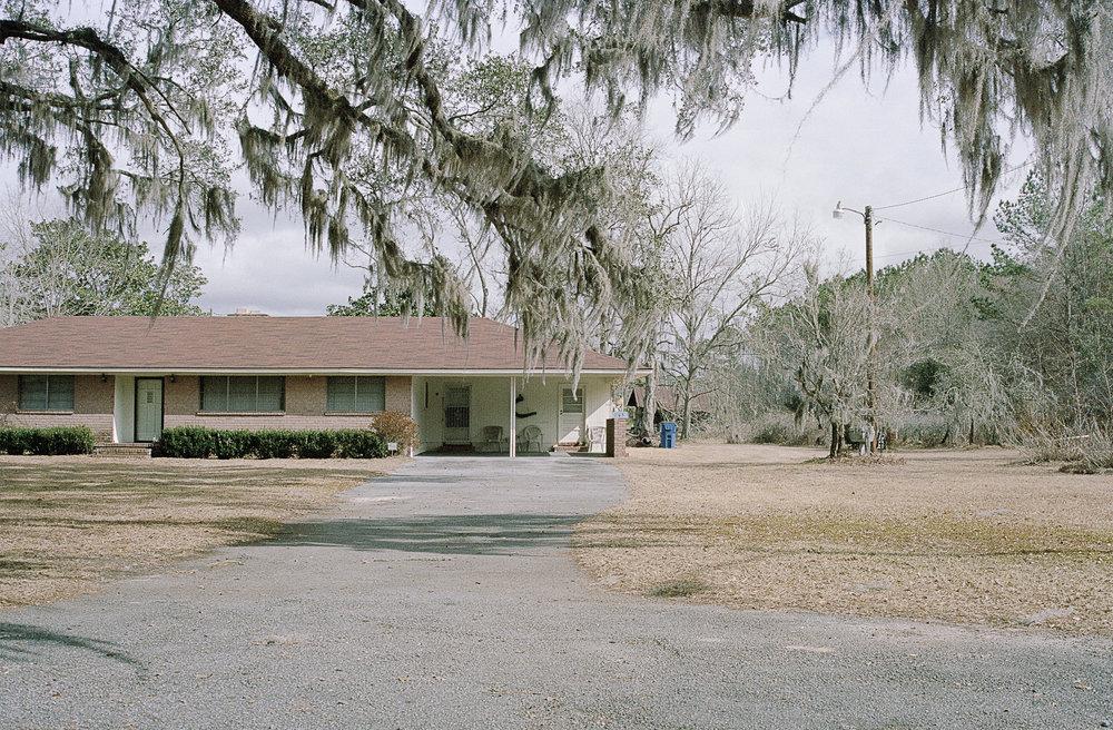 house with blue trashcan_.jpg