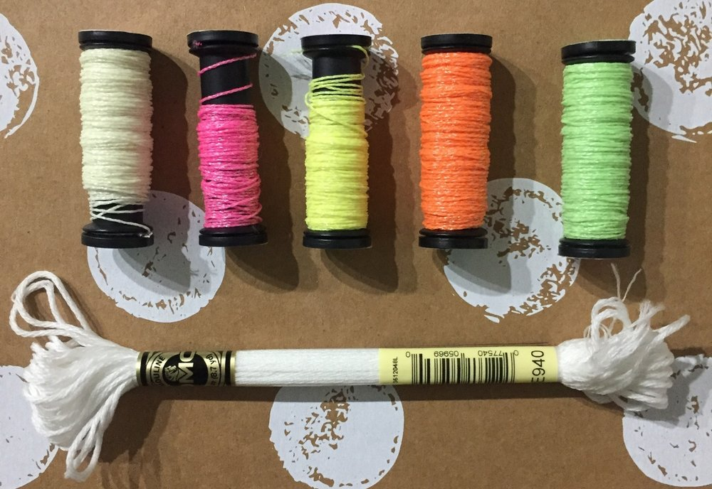 Top (left to right) : Kreinik 052F, 055F, 054F, 051F, 053, #8;  Bottom : DMC E940.