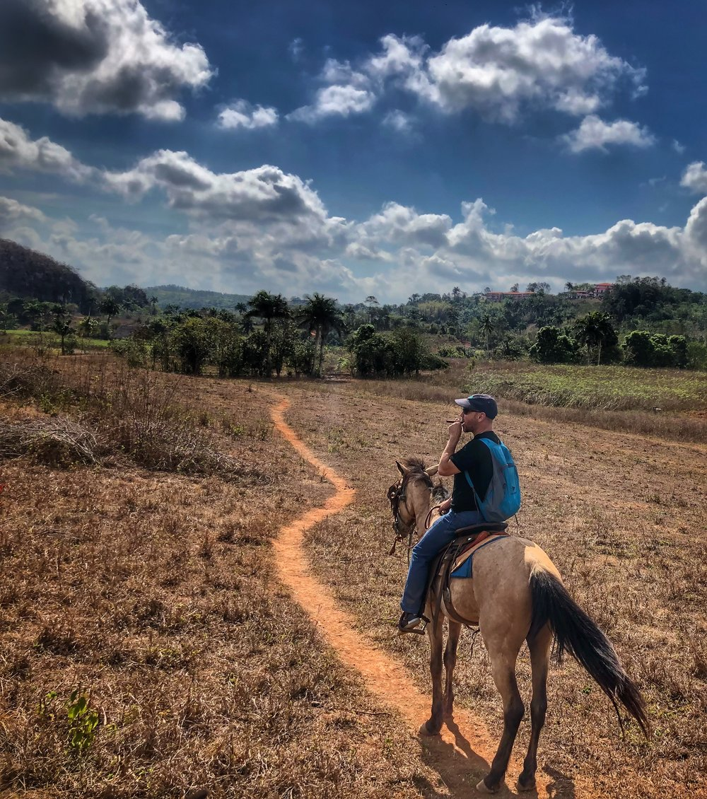 Viñales Valley - Riding through the Viñales Valley, smoking my Cuban, was an experience of a lifetime. Viñales is a small town in the country, ~2.5hrs from Havana. While not exactly a secret, with seemingly every local renting a room in their house, it still holds it's charm. I went horseback riding through the valley with only my guide Humberto from Authentic Viñales Tours. We visited local farms, including his friend's tobacco farm, where they had just killed a 7ft constrictor who was eating their chickens! I learned about the tobacco process and even rolled my own cigar...with a little help! Growers are able to keep 10% of their crop to sell and use. They keep the best...so this is where to buy your cigars...for a fraction of the cost.