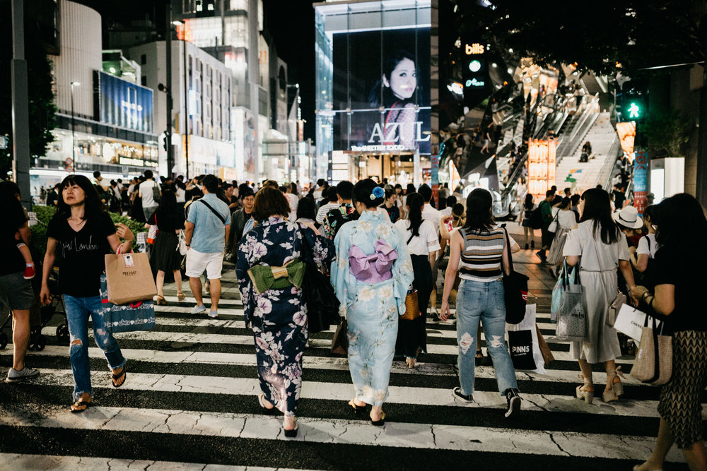 Japanese women dressed in traditional kimono crossing street in Harajuku Tokyo Japan