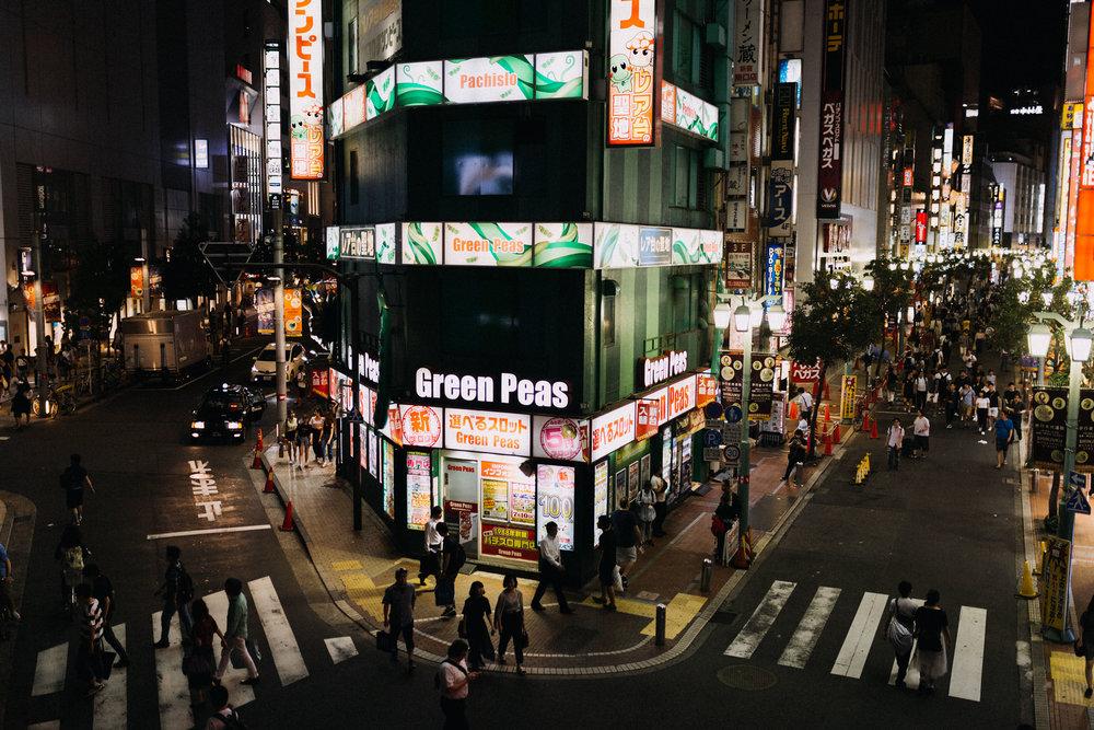 Shinjuku nightlife highrise buildings street corner in Tokyo Japan