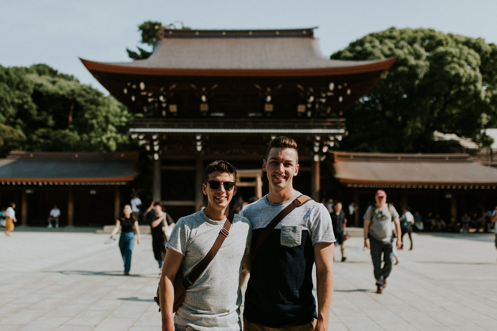 Gay backpackers lgbt husbands matthew and michael in Meiji Jingu Shrine in Yoyogi Park Tokyo Japan