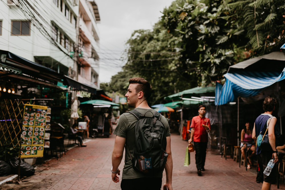 Man backpacking Khao San Road.jpg