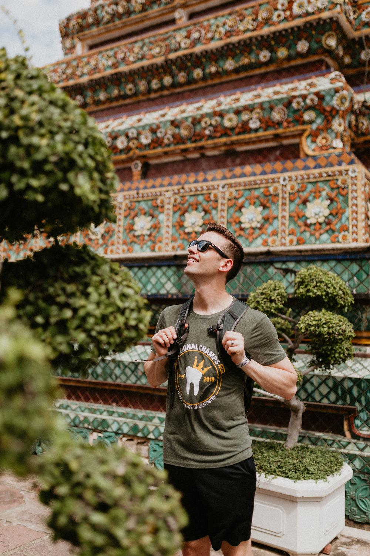 Tourist viewing Wat Pho.jpg