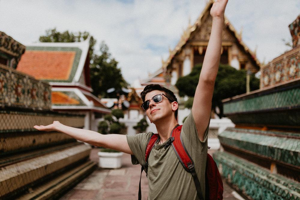 man taking photos at Wat Pho.jpg