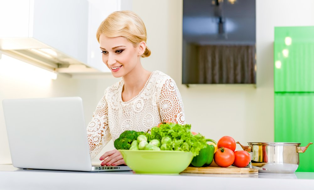 young woman looking at cooking videos on youtube