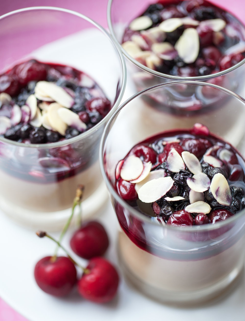 Vegan rice pudding with cherries and almond flakes