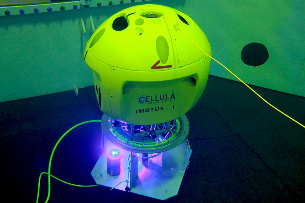 subsea charging and data transfer - An optional docking station allows Imotus-1 to be permanently deployed at the work site. Inductive power transfer allows recharging when docked and a blue-light modem provides real-time, high bandwidth communications.
