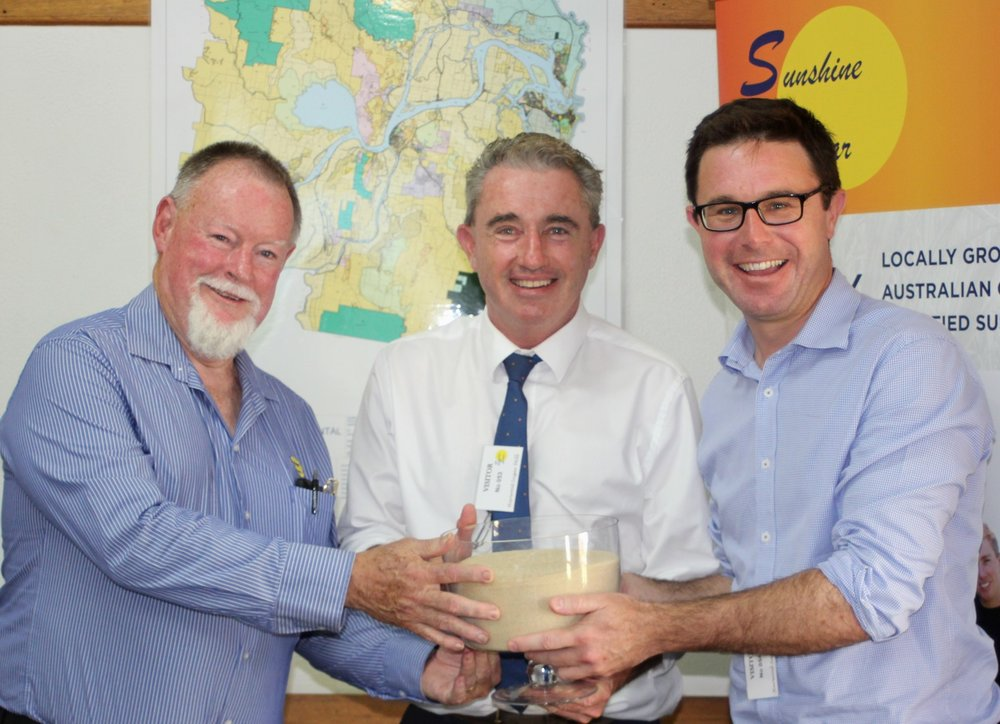 Photo L to R: Chris Connors, CEO of Sunshine Sugar; Kevin Hogan, Member for Page, holding a bowl of locally produced Low GI sugar; David Littleproud, Minister for Agriculture.