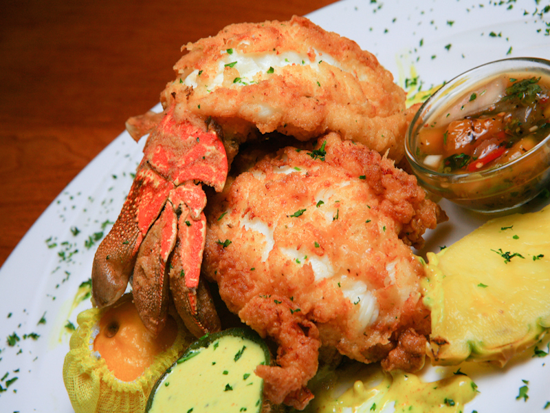 Kiwi Fried Twin Cold Water Lobster Tails - $62 – Served with a kiwi honey mustard sauce and mango chutney