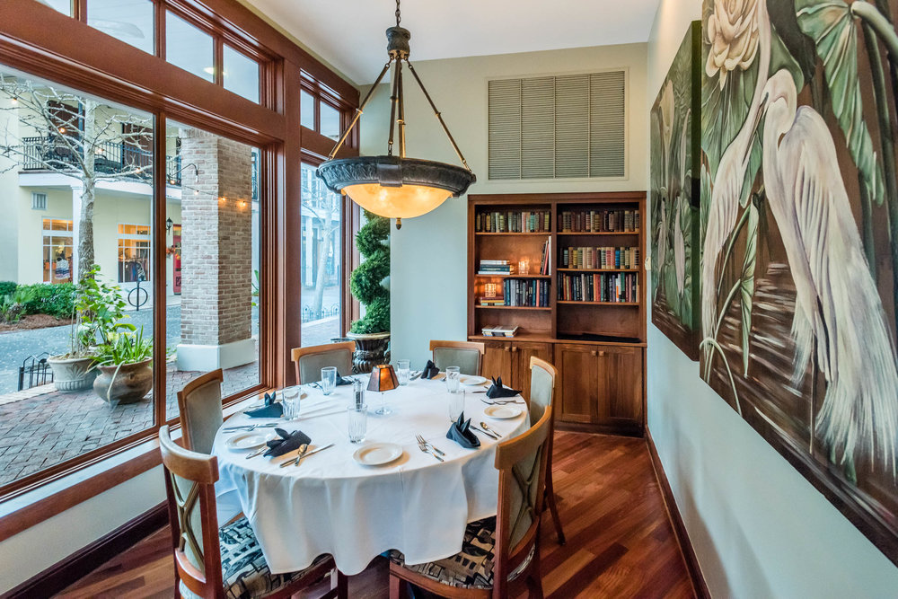 The Cove - The Cove accommodates up to eight guests and provides for an intimate evening. A table set back in a private room containing a book shelf for a comfortable, relaxing ambience.