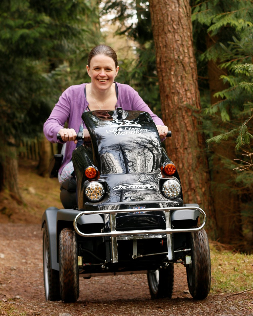 Julia Walker manager of Lake District Mobility, trialling Whinlatter's new Tramper