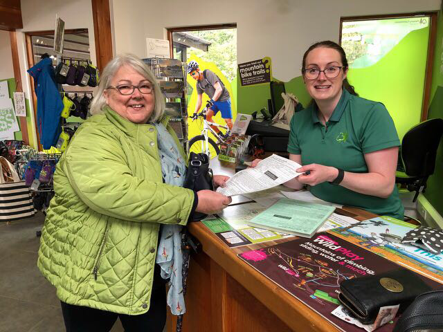 Pat Newlove signing up for her Lake District membership with Sonia at Whinlatter Forest.