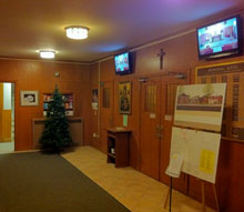 Local monitors in the narthex are used for both the PSNE Digital Bulletin and overflow viewing.