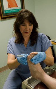 Doctor Removing Calluses from Foot, Moon Twp