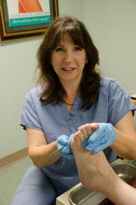 Dr Teimouri shaving a callus