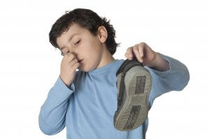 Child with smelly shoes and foot odor