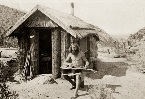 Nature Boy Bill Pester at his shack near Palm Springs, California, 1917. Image Source:  Frieze