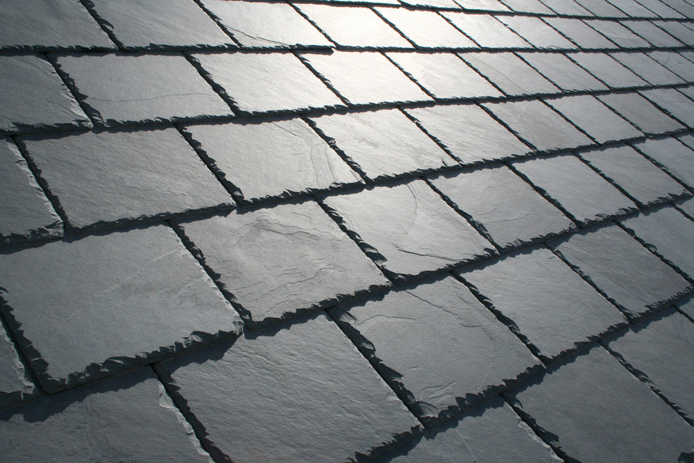 Slate roofs - Roofing slate is a thick, durable, naturally occurring material that is basically nonabsorbent. Slate's color is determined by the mineral & chemical composition; furthermore, exposure to the natural elements cause slate's original color to change (degree of change is dependent upon the slate).
