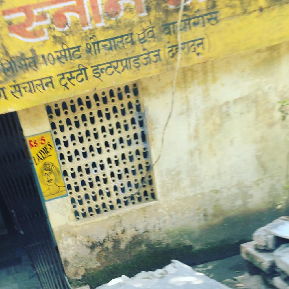 One of the strangest things to adjust to has been the bathroom situation. There are open urinals on the streets for dudes, but few enclosed public restrooms. Yesterday, I went up to this bathroom – free for men, 5 rupees for women. Couldn't get a pic of the sign.  (at Laxman Jhula)