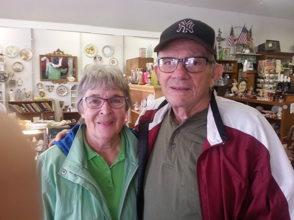 - Jerry and Phyllis keep their shelves filled with lovely glass, fun hats, vintage jewelry and Hawkeye items.