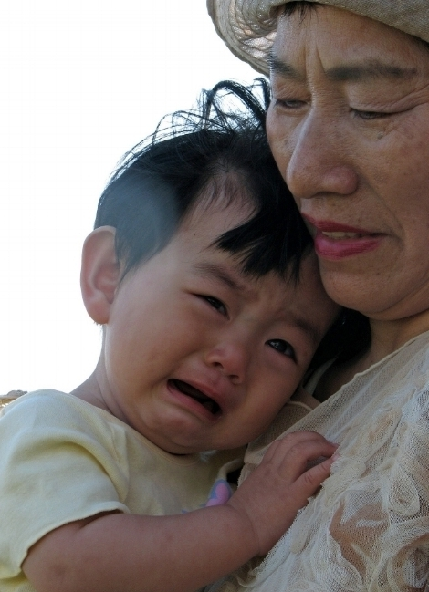 baby crying with grandma.jpg