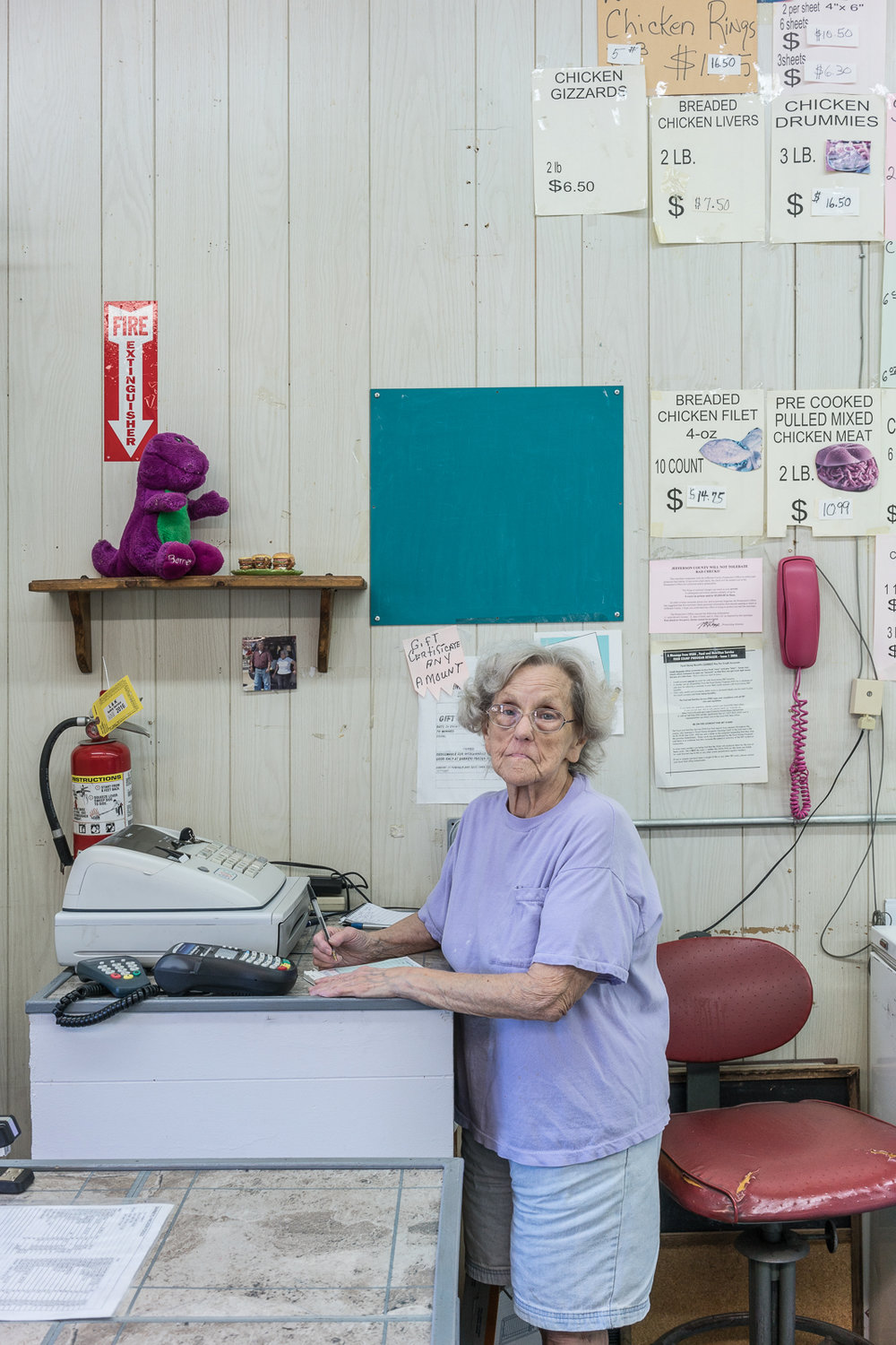 Juanita at the Frozen Foods Shop, De Soto, Missouri, 2017 © Nate Larson