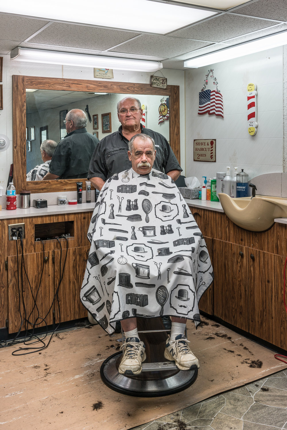 Jerry and Larry at the Barber Shop, De Soto, Missouri, 2017 © Nate Larson