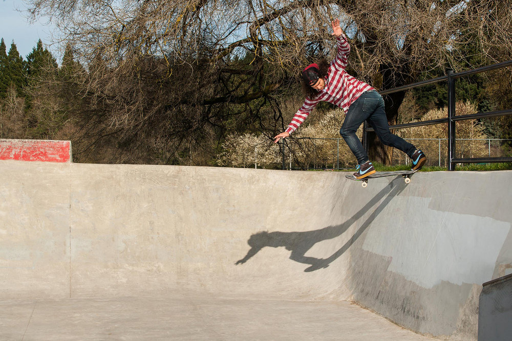 Al Partanen takes a backside tailslide into a rarely skated section of Pier Park Skatepark's street area.