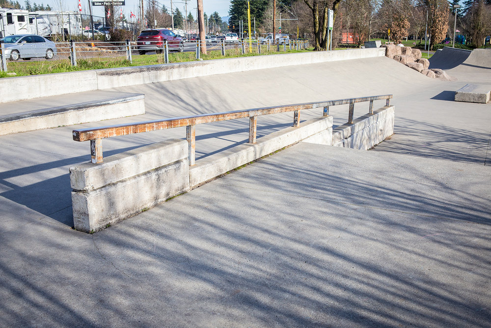 A lengthy square rail awaits those seeking thrills at Ed Benedict Skate Plaza.