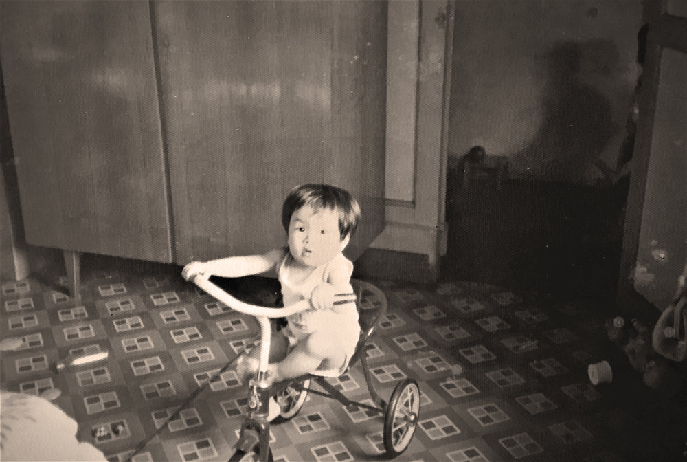 Charmaine riding up and down the corridor of 15A Keong Saik Road on her bicycle before she developed an intense love-hate relationship with it