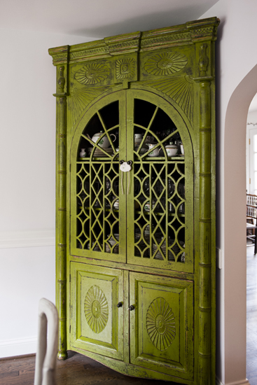 green dining room corner cabinet