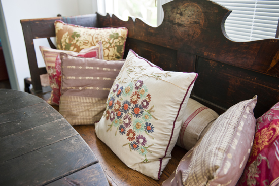 reclaimed bench & floral pillows