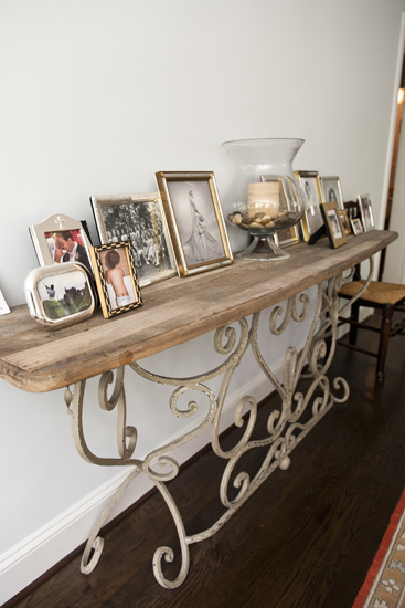 console table with family pictures