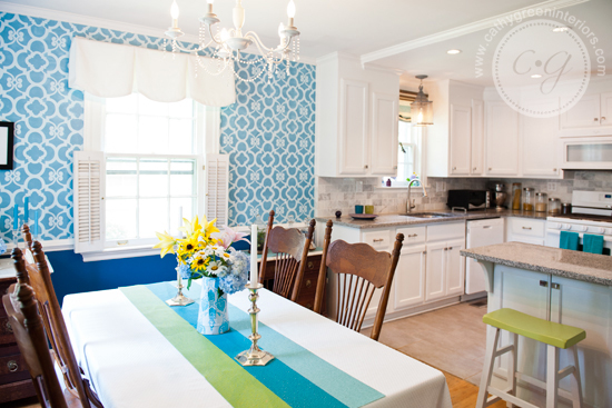 white kitchen and blue stenciled dining room