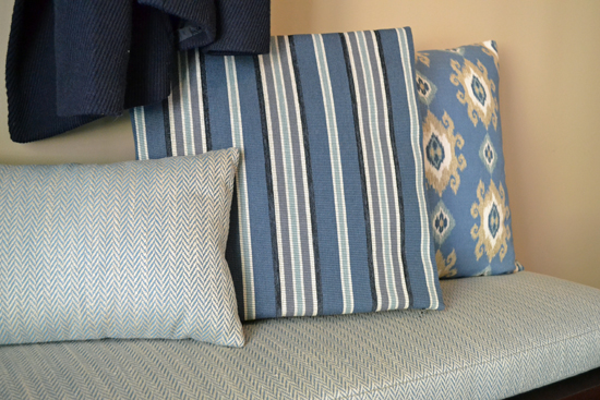blue pillows on a foyer bench