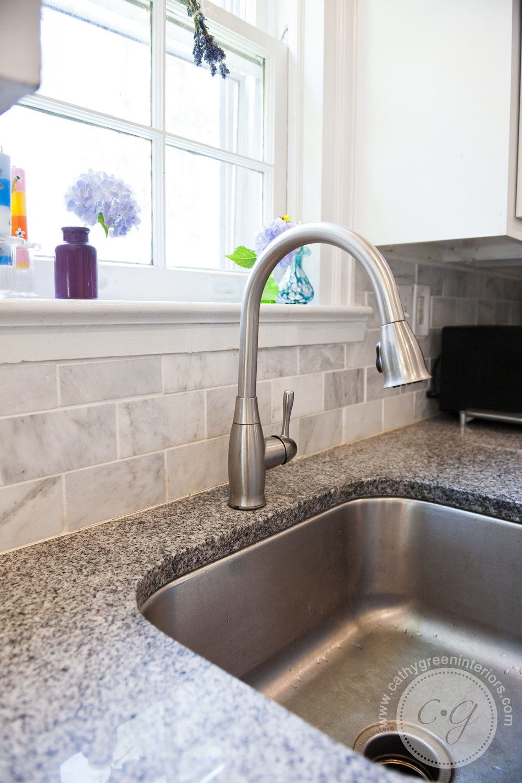 marble backsplash and luna pearl granite.jpg