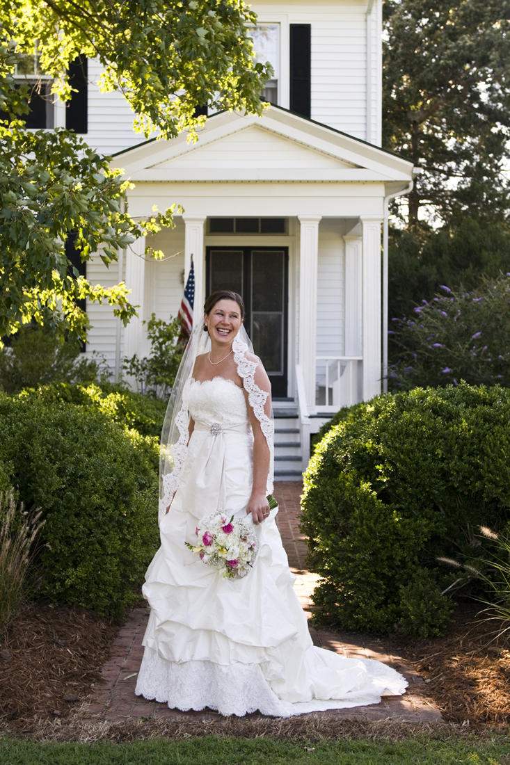Jess on her wedding day in front of the farmHouse!                                                                  Beth furgurson photography