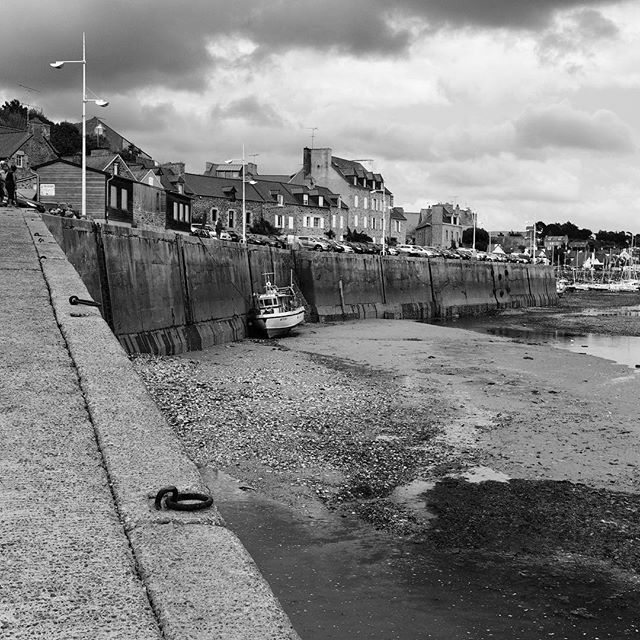 #pleneufvalandre #bretagne #portdahouet #france #photographer #mareehaute #sea #water #boats #docks #empty #blackandwhitephotography #blackandwhite #lighthouse #marine #holidays #notasunnyday #cloudy #windy #reflection #summer #holidays