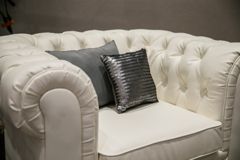 Malloy Weddings | New England wedding furniture rentals | White tufted leather chair wedding furniture rentals