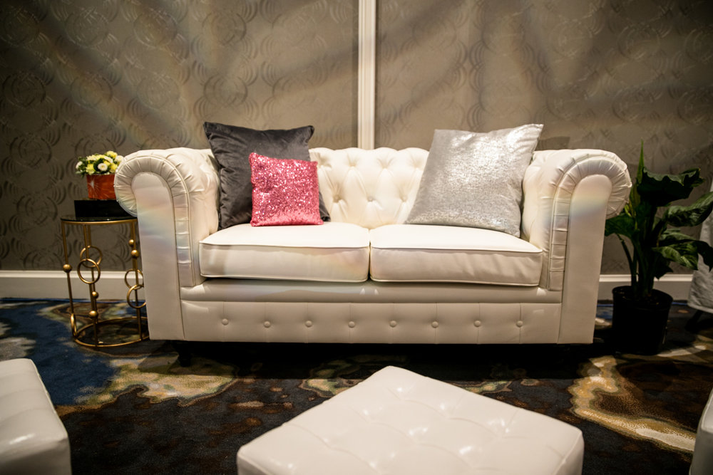 white tufted couches