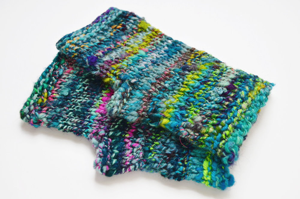 hand knit fingerless gloves by Taylor Chona