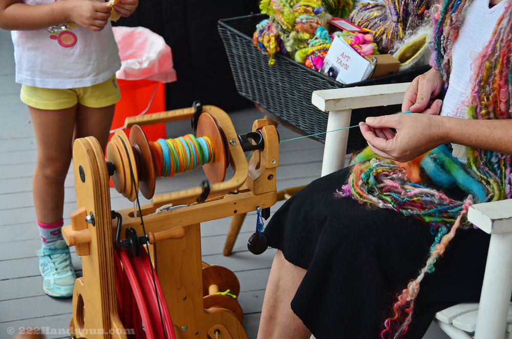 Kristin (August Moon Farm) demonstrating how to spin yarn
