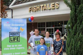 "Rhonda Bradley, owner of Fishtales, is pictured with the Oyler family at the ""Coffee for a Cause"" event which was held in support of the aHUS Foundation and Donate Life."