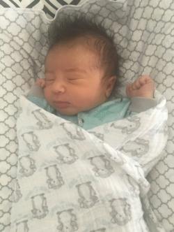Fast asleep in the DockATot at 1 week old