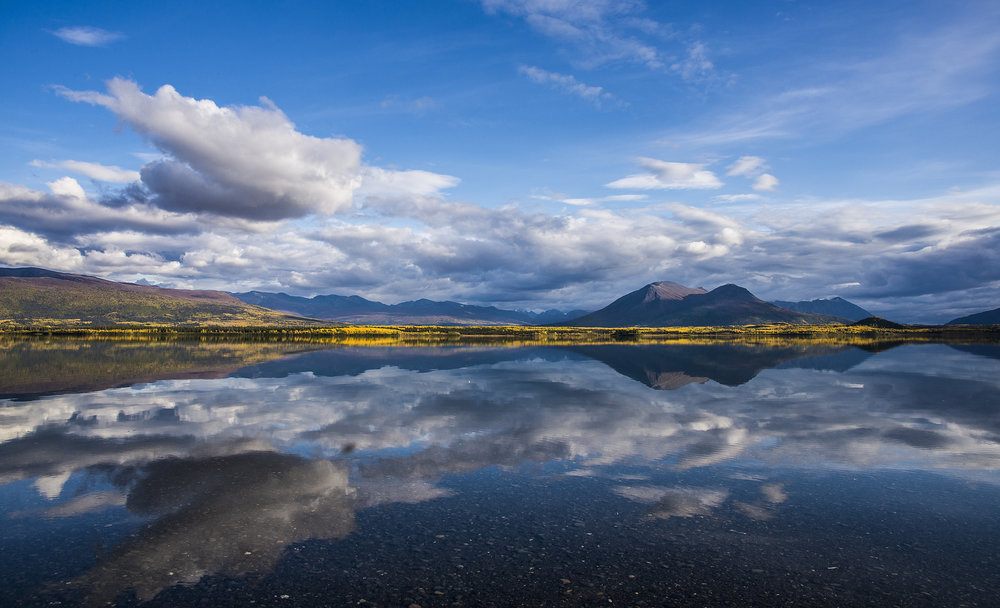 Beautiful cloud reflections by Chris Pepper